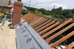 re-roofing in progress - AM Roofing Contractors